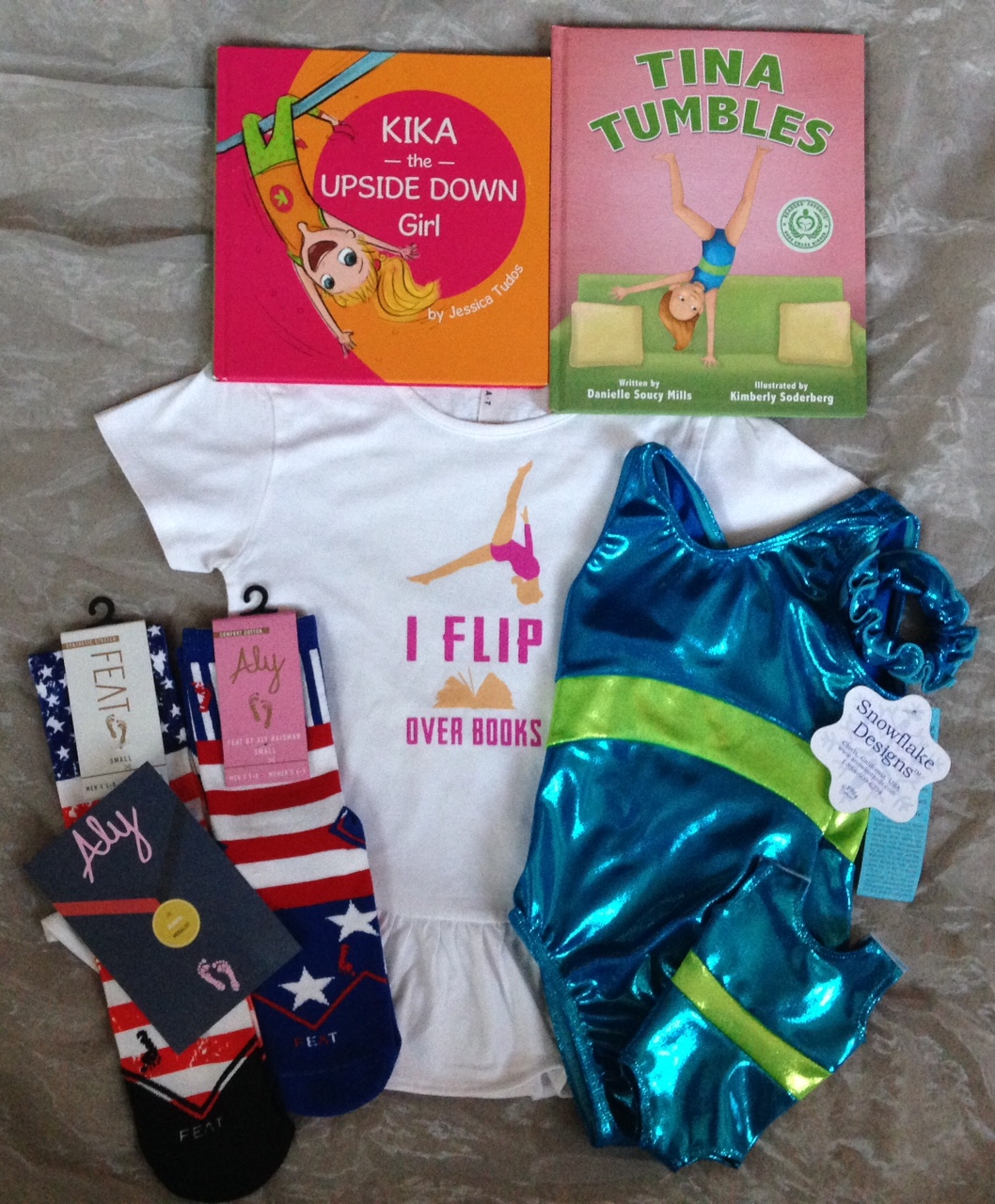 Tina Tumbles, Kika the Upside Down Girl, Leotard set by Snowflake Designs, I Flip Over Books T-shirt, Feat socks including Feat by Aly Raisman